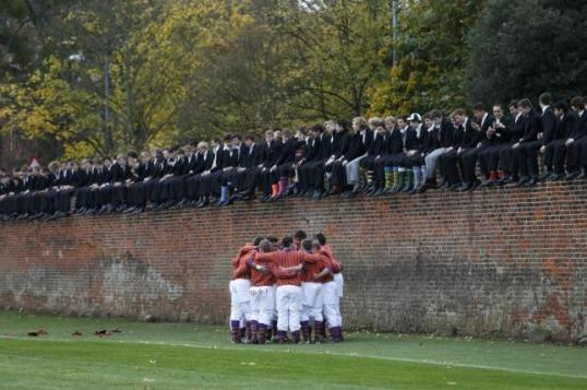 Pupils huddle during the Eton Wall Game at Eton college in Eton, near London